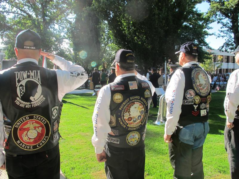 Members of the Patriot Guard Riders salute the flag during the Boise memorial.