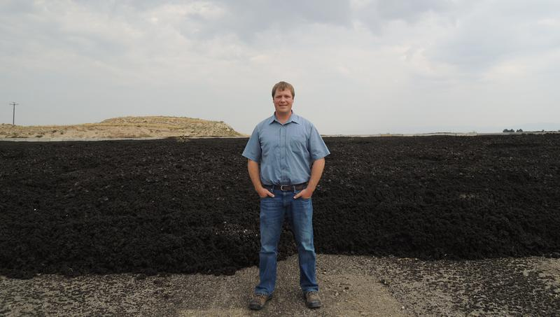 "Ben Nydegger on one of five biosolids ""bunkers"" at Boise's 20 Miles South Farm."