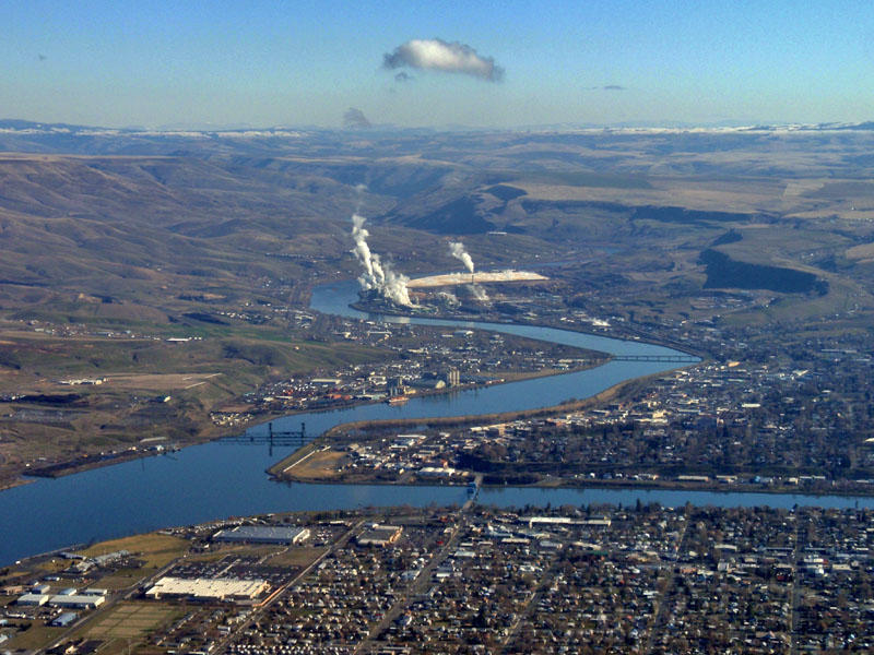 The Port of Lewiston hugs the left bank of this aerial view of the confluence of the Snake and Clearwater Rivers. Clarkston is at lower right.
