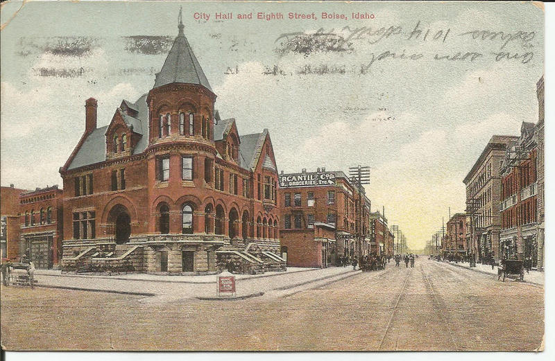 This postcard is looking south down 8th Street from Idaho Street. Aden says none of these buildings exist today.
