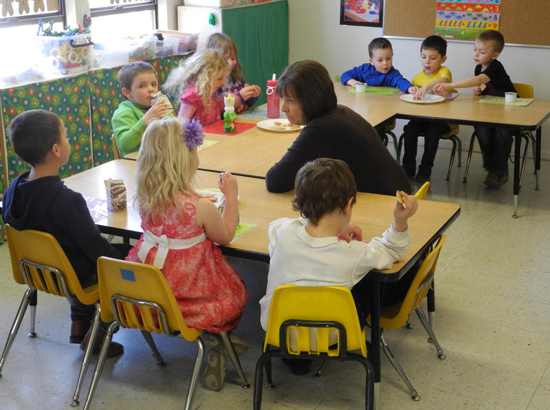 Basin preschool teacher Mary Allen speaks with children during a recent afternoon snack time.