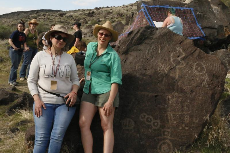 Nikki Gorrell (right) and sketch artist Dunia Rossi (left) stand next to a petroglyph. Many of the boulders are giant, weighing several tons.