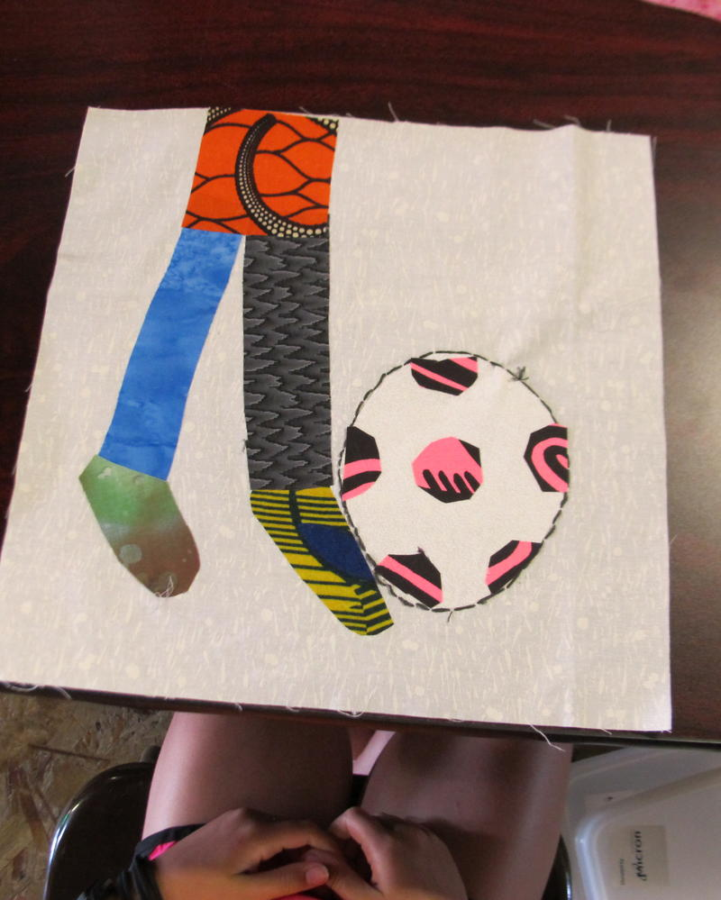 "A lot of the kids in the ""Quilting to Speak"" workshop really like soccer and show it in their quilting squares."