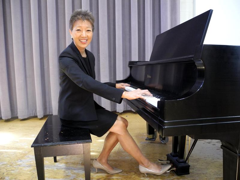 NEA Chairman Jane Chu sits at her instrument of choice at the Esther Simplot Center for the Performing Arts in Boise.