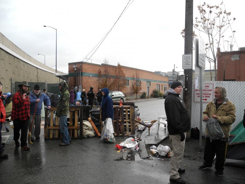 Homeless advocates, Boise Police and people who have been staying in the area known as Cooper Court mill around in the alley Friday morning. The city has told the homeless residents there it's time to leave.