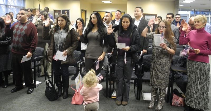 During the oath Valeriya Roseberry's daughter wanders up to stand in front of her mother.