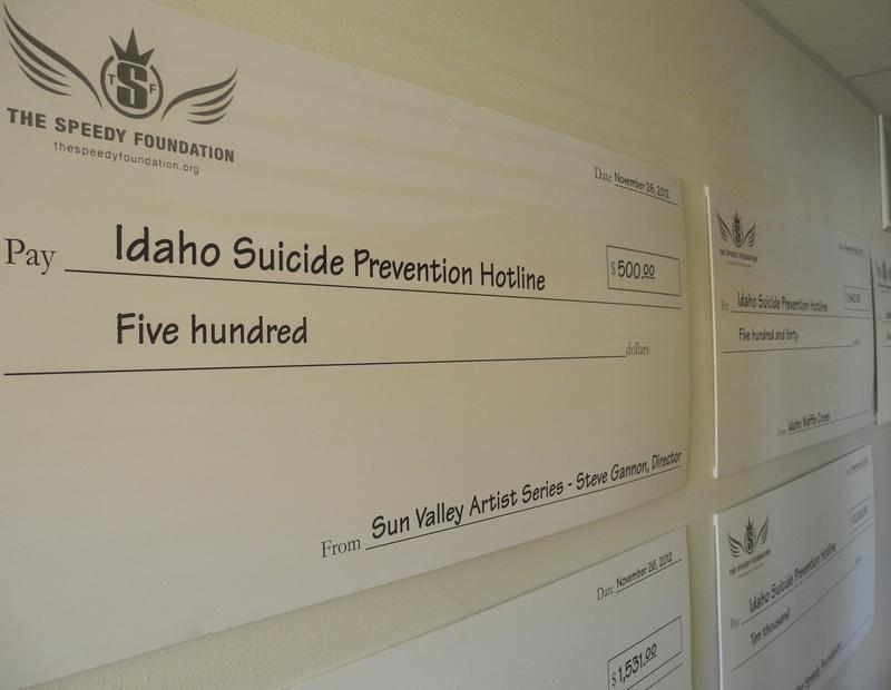 Oversized checks from nonprofits line the hall at the Idaho Suicide Prevention Hotline. The Hotline doesn't have a reliable funding source. The HQPC wants the legislature to commit to pay 60 percent of its operating costs.