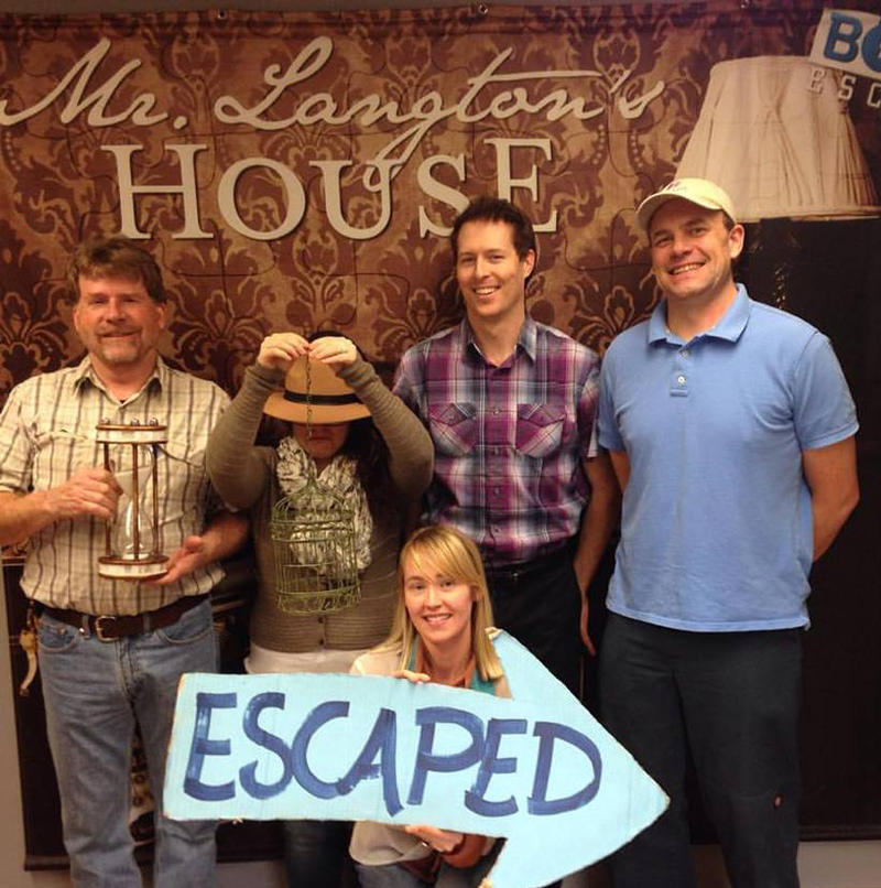"Team KBSX poses for a picture after escaping from ""Mr. Langton's House."" Left to right Richard Strack, Lacey Daley, Erik Jones, Paul Cox and Frankie Barnhill holds the sign."