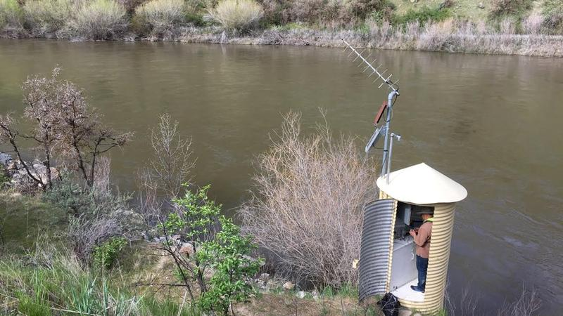 A USGS technician checks the gauge on the Payette River near Horseshoe Bend.