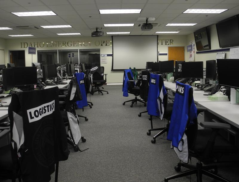 The Idaho Emergency Operations Center before a drill begins. Vests with lables like, logistics, plans and operations wait on each chair.