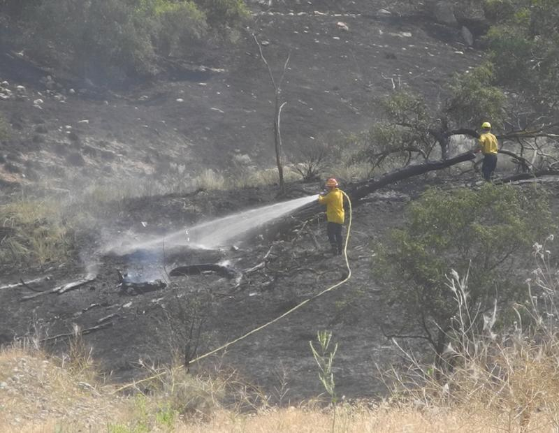 Firefighters were still working to contain the Table Rock Fire late Thursday morning.