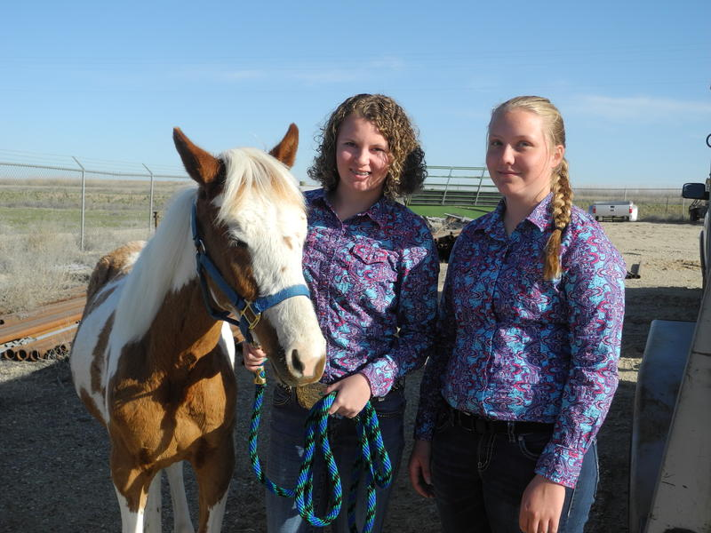Brittani Cooper and Johna Dhuyvetter with their horse Red Rider.
