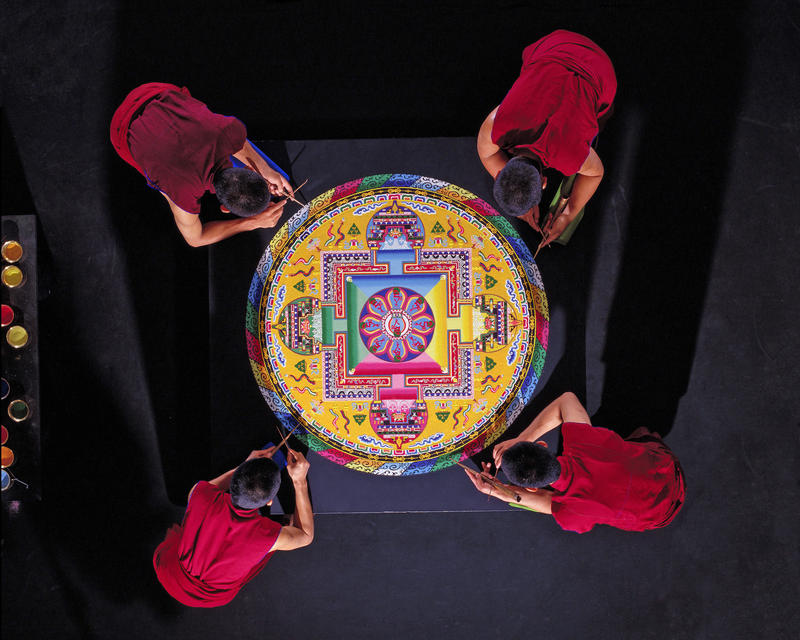 Monks working on a mandala.