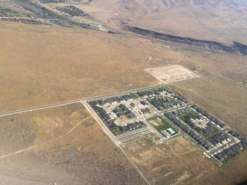 An aerial view of the Treasure Valley helps elucidate the area's water challenges. Development hinges on finding a reliable water supply. From above, landscapes with water look green, while the no-water areas look brown.