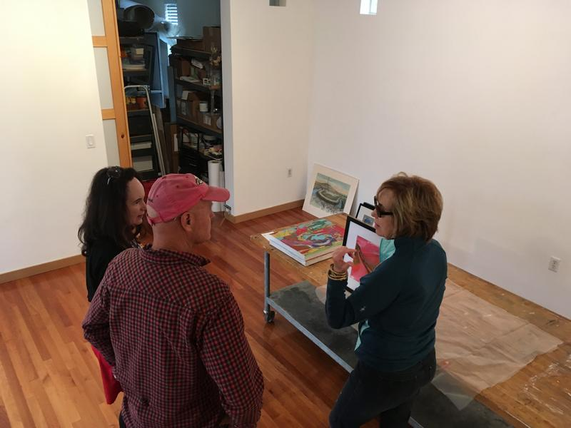 Artists Katy Shanafelt (L), Steven Gossett and Sara Hill (R) setting up their work for the Surel's Place PopUp shop.