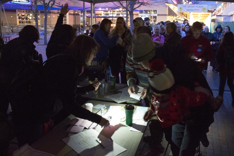 When voter registration runs hours past dark, Ada County Democrats volunteers register caucus-goers using cell phone flashlights at the Democratic caucus in Boise, Idaho, Tuesday, March 22, 2016.