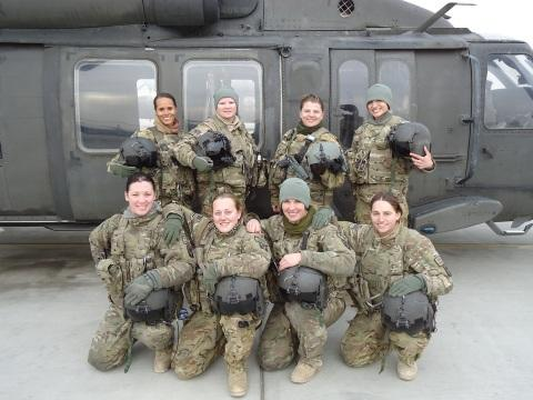MAJ Nicole Washington (back row, left) and her all-female flight crew. Washington is the first female aviator to be rated to fly the Attack Helicopter (AH-64) and Utility Helicopter (UH-60).