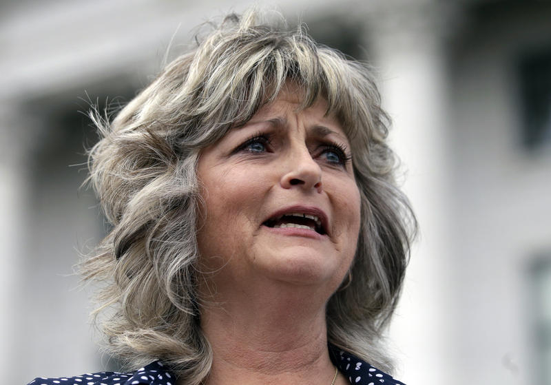 This Saturday, March 5, 2016, file photo, Jeanette Finicum speaks with reporters during a rally at the Utah State Capitol, in Salt Lake City.