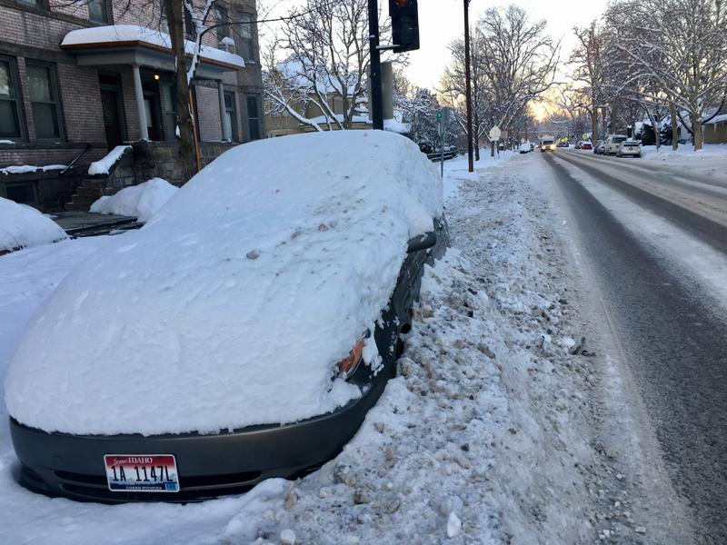 This car was plowed in after ACHD crews cleared Fort Street in Boise.