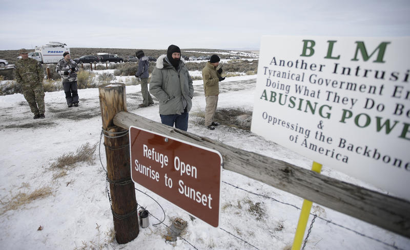 In this Monday, Jan. 4, 2016, file photo, members of the group occupying the Malheur National Wildlife Refuge headquarters stand guard near Burns, Ore.