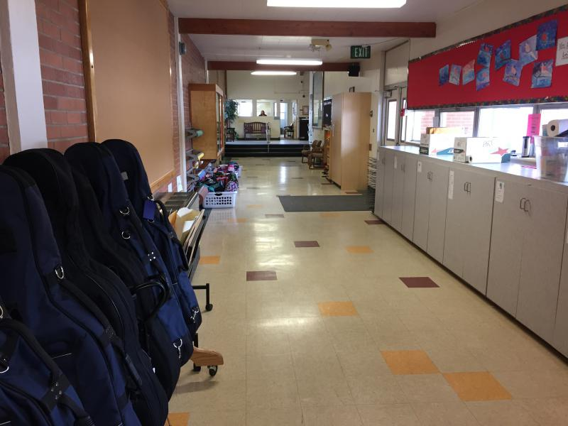 A hallway at Highlands is a functional space. Students' band instruments are kept on one side, and the other is used for storage and class prep.