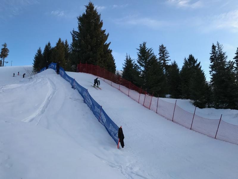 A ski racer from the McCall Winter Sports Club lands and speeds down the run-out of a 30-meter Nordic jump at the Little Ski Hill. The kids spent nearly six weeks grooming the jump, which hadn't been used in about 15 years.