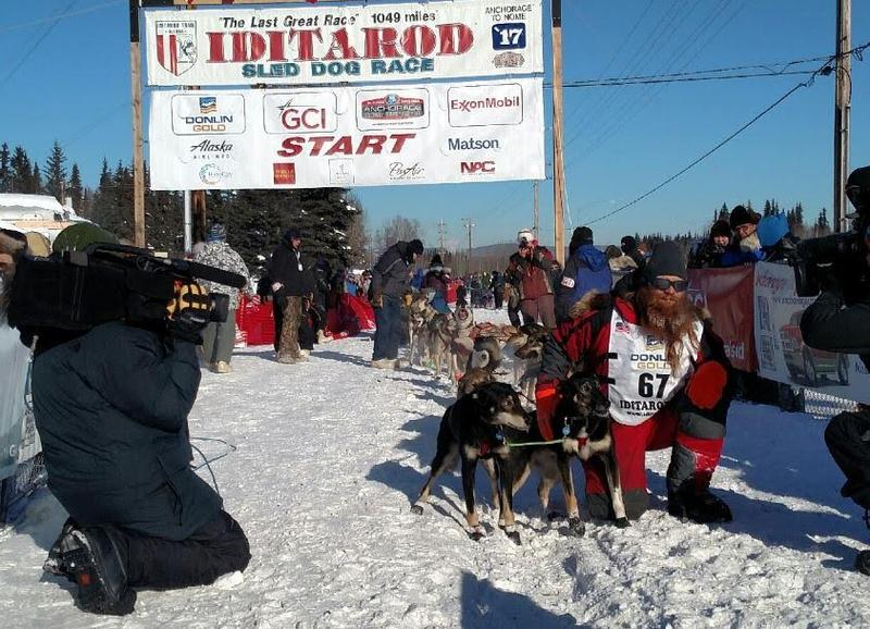 Trent Herbst pauses for a photo at the start of the 2017 Iditarod with his lead dogs Ayn and Scott. (Used with permission.)