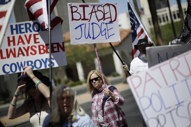 Protesters outside a Las Vegas courthouse in April 2017 where defendants accused of wielding weapons to stop federal agents from rounding up cattle near Nevada rancher Cliven Bundy's property in 2014 are on trial.