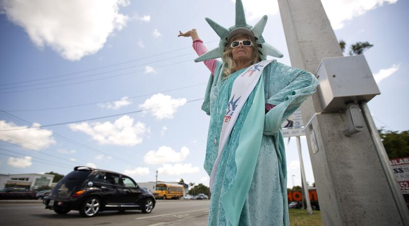 File photo of Denise Monsen dressed as the Statue of Liberty in Pembroke Pines, Fla. in April 2015.