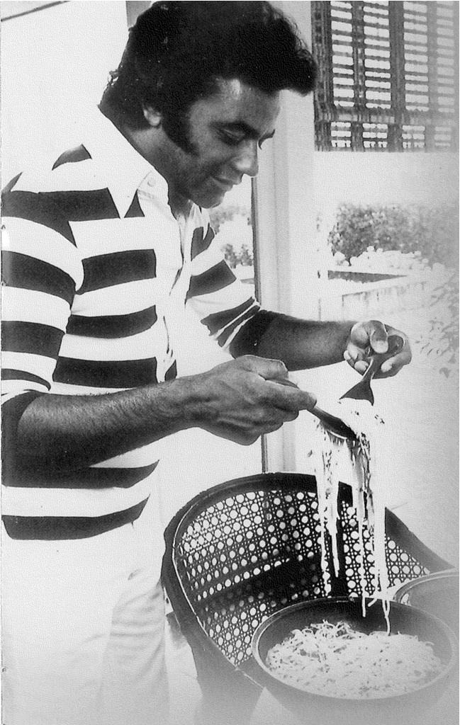 When he isn't on stage, Johnny Mathis is a gourmet cook. Here he is cooking at home in the 1970's.