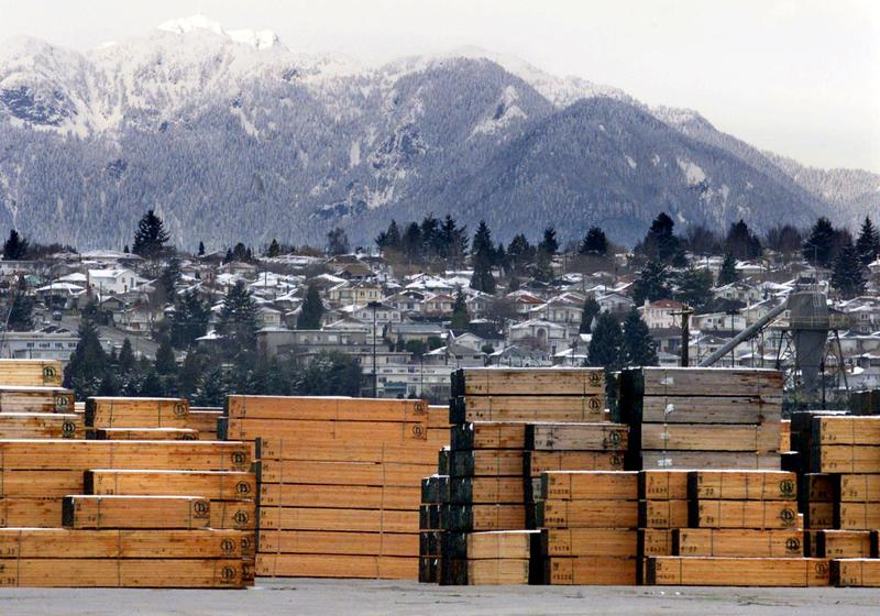 Piles of softwood lumber destined for export, are stacked at a Richmond, B.C., Canada lumberyard, March 20, 2002.