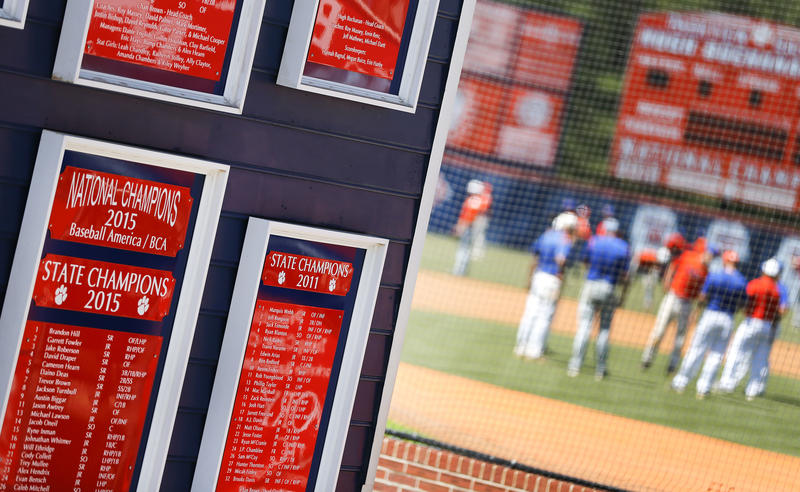 Plaques mark the accomplishments of the Parkview High School baseball team as they warm up before a baseball game in Lilburn, Ga., on Wednesday, April 26, 2017.
