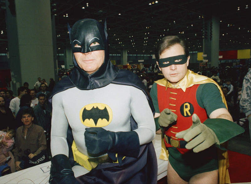 """In this Sunday, Jan. 27, 1989 file photo, actors Adam West, left, and Burt Ward, dressed as their characters Batman and Robin, pose for a photo at the """"World of Wheels"""" custom car show in Chicago."""
