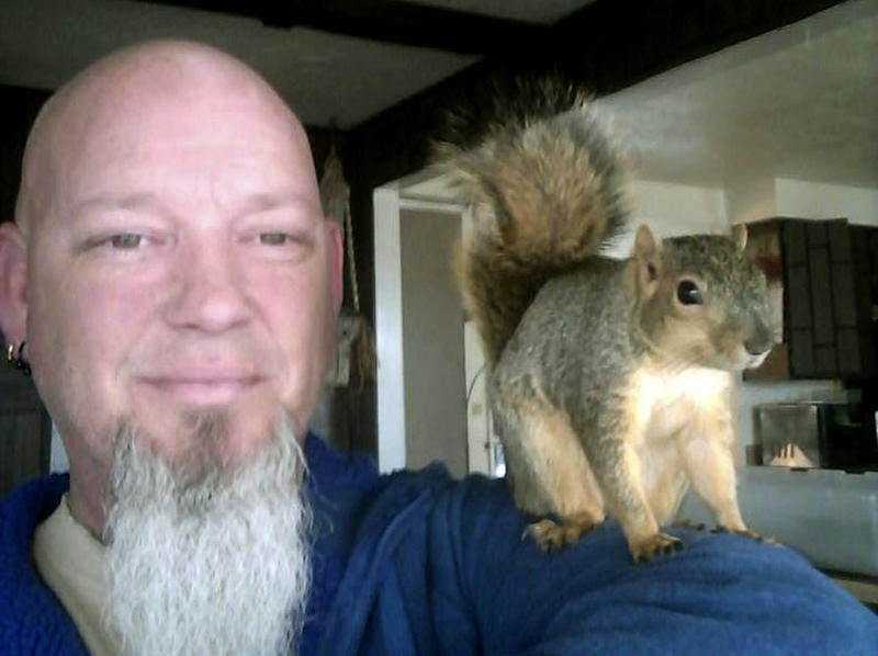 This undated photo provided by Adam Pearl shows Pearl with his pet squirrel Joey in Meridian.
