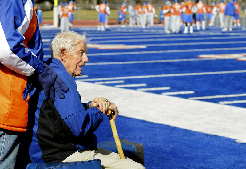 Former Boise State football coach Lyle Smith sits along the sidelines watching the Boise State workout on the first day of spring football practice on Monday, March 9, 2009 at Bronco Stadium in Boise, Idaho.