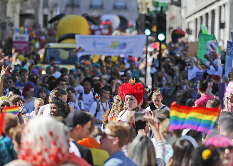 Revelers enjoy the Pride London Parade in London, Saturday, July 8, 2017.