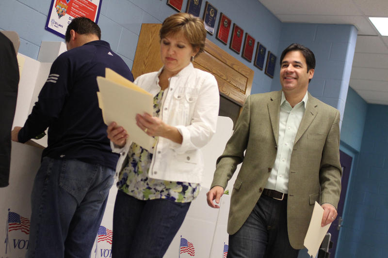 Republican candidate for Idaho congress Raul Labrador walks out of a polling station with his wife Rebecca after casting their votes on Tuesday, Nov. 2, 2010 in Eagle, Idaho.
