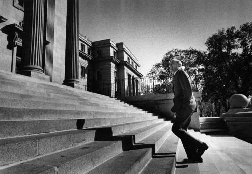 Governor Cecil Andrus walks up the front steps of the Idaho State Capitol Building.