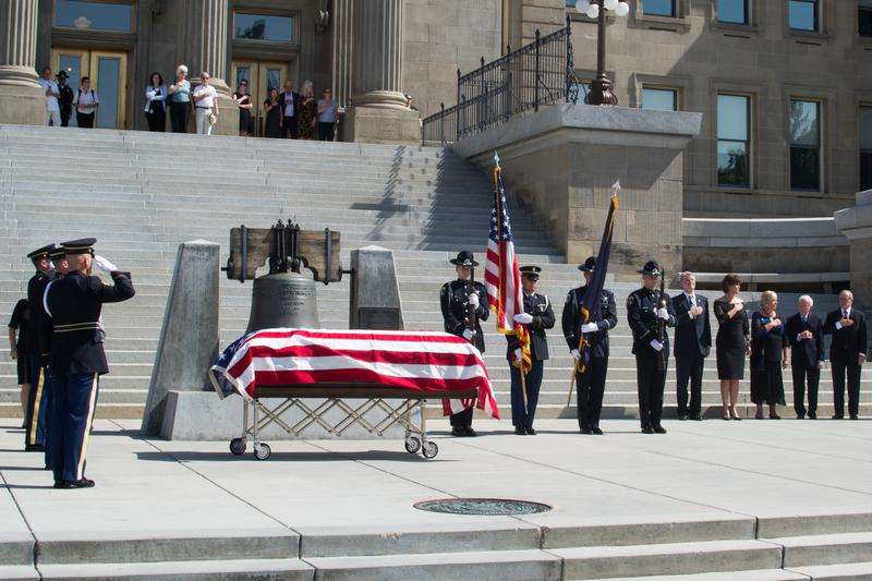 "Governor C.L. ""Butch"" Otter stands with former governors Phil Batt and Jim Risch as an Honor Guard salutes Cecil Andrus."