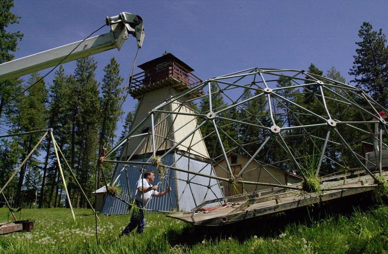 A worker moves children's play equipment from the former headquarters of the neo-Nazi Aryan Nations in May of 2001, near Coeur d'Alene, Idaho. Internet millionaire Greg Carr decided to destroy the buildings and celebrate human rights at the 20-acre site.