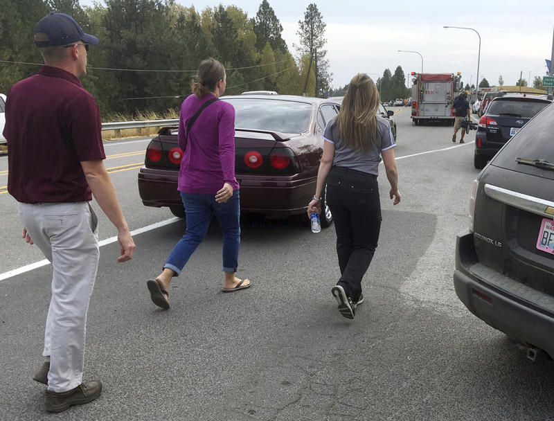 """""""People hurry toward Freeman High School in Rockford, Wash., Wednesday, Sept. 13, 2017. Parents rushed to the area after a deadly shooting at the school."""""""