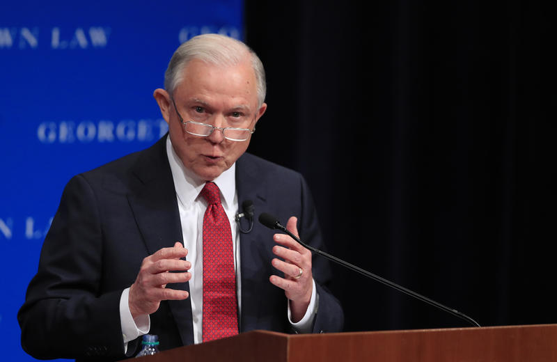 Attorney General Jeff Sessions speaks at the Georgetown University Law Center in Washington Tuesday. Sessions says the U.S. Justice Department will intervene on behalf of people who sue colleges claiming their free speech rights were violated.