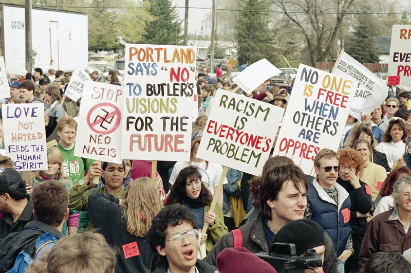 People gather to march out of Coeur d'Alene, Idaho, April 22, 1989 to protest against a nearby neo-Nazi skinhead conference being held at the white supremacist Aryan Nations Church compound in Hayden Lake.