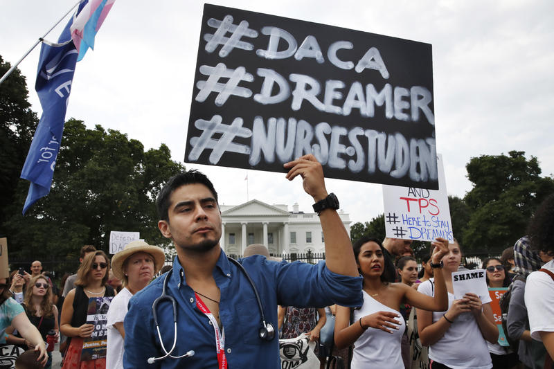 Carlos Esteban, 31, of Woodbridge, Va., a nursing student and recipient of Deferred Action for Childhood Arrivals, known as DACA, rallies with others in support of DACA outside of the White House, in Washington, Tuesday, Sept. 5, 2017.