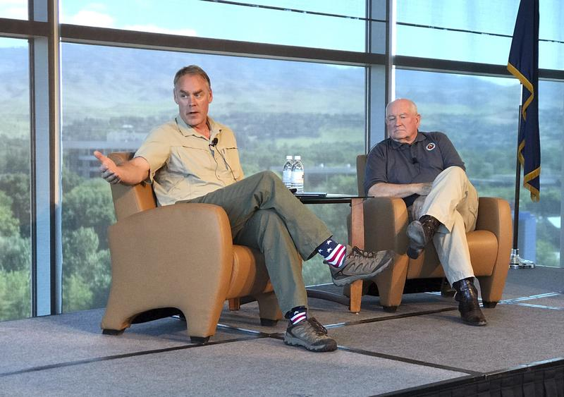 U.S. Interior Secretary Ryan Zinke, left, and Agriculture Secretary Sonny Perdue speak in Boise, Idaho, on Friday, June 2, 2017.