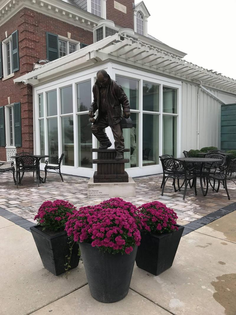 "The bronze sculpture ""The Last Whistle"" stands in its new home in Michigan."