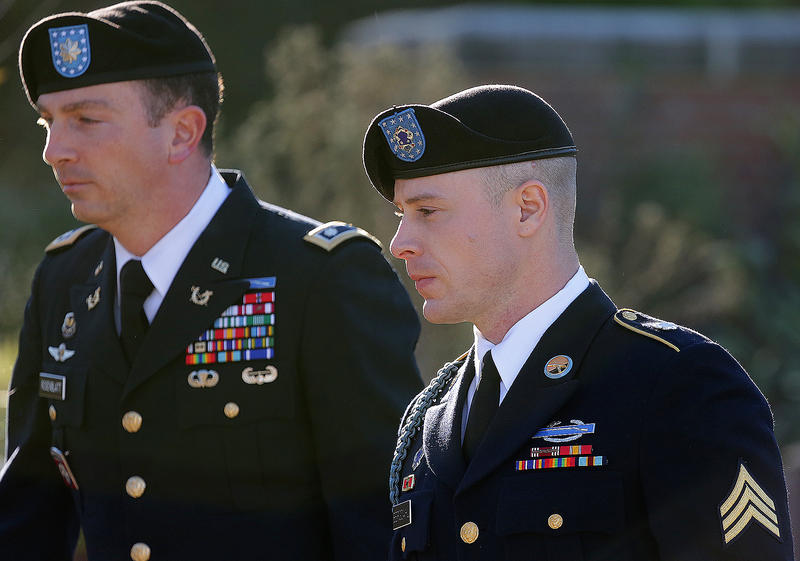 Army Sgt. Bowe Bergdahl, right, arrives for a pretrial hearing at Fort Bragg, N.C., with his defense counsel Lt. Col. Franklin D. Rosenblatt, left, in January 2016.