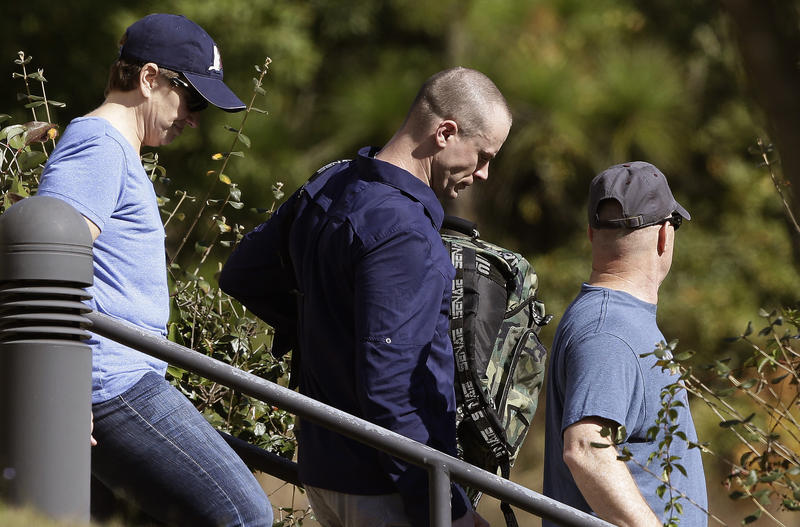 Bowe Bergdahl, center, leaves the Fort Bragg courtroom facility following sentencing at Fort Bragg, N.C., Friday, Nov. 3, 2017. The former Sergeant was spared any prison time and received a dishonorable discharge from the Army.