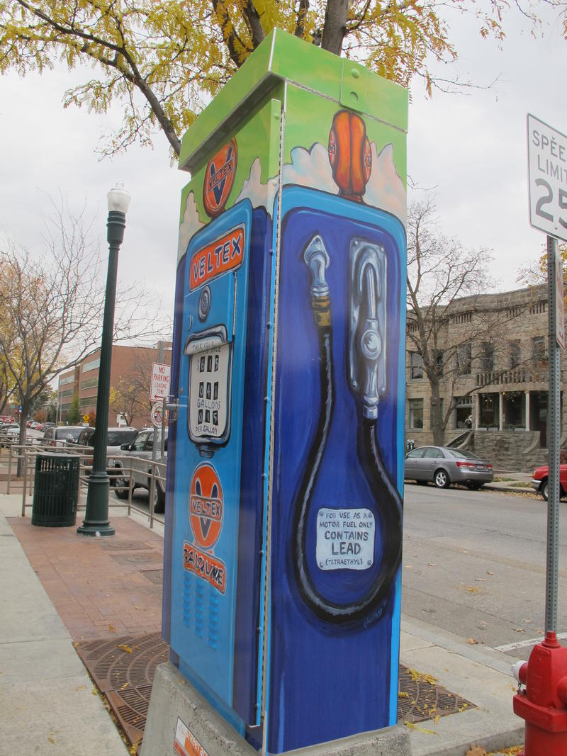 """When Oil Was King"" by Pat Kilby covers all four sides of an otherwise unassuming traffic control box."