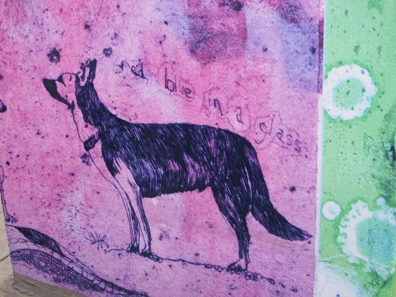 """Haiku For Capitol Park"" by Jill AnnieMargaret sits at 6th and Bannock and features a squirrel and several dogs."